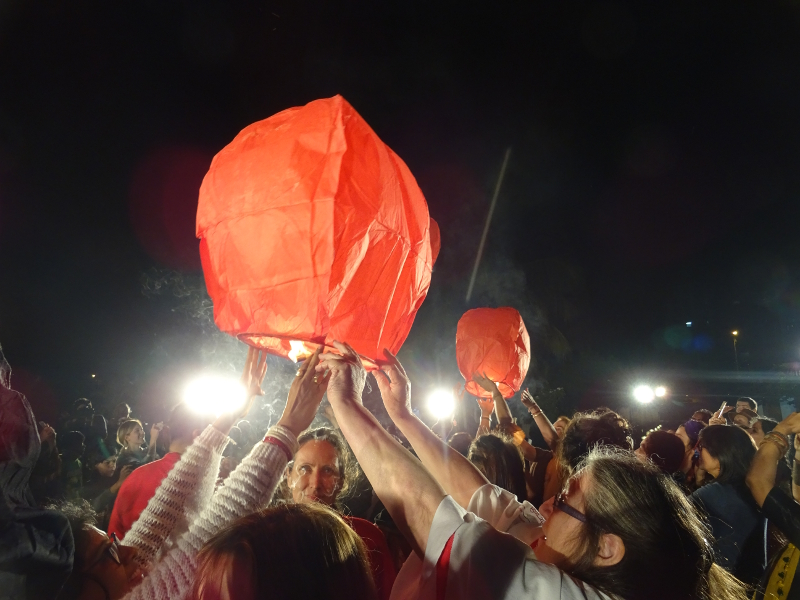 Launching fire lanterns at the festival opening.
